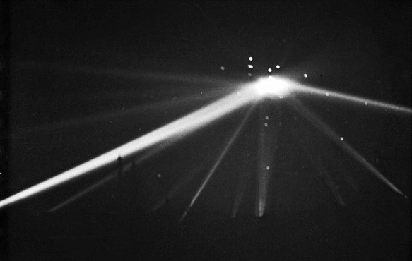 Feb. 25, 1942: Searchlights converge on unknown object over Los Angeles in the early morning hours. Over 1400 rounds of anti-aircraft rounds were fired, with rounds with many rounds landing on the ground. This is unretouched version.